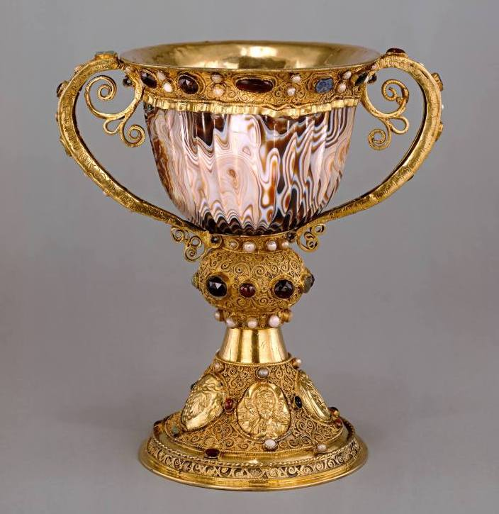 The beautiful gilded chalice was commissioned by Abbot Suger of St Denis, France, in the twelfth century, while its sardonyx cup was made in Alexandria in the second century BCE.